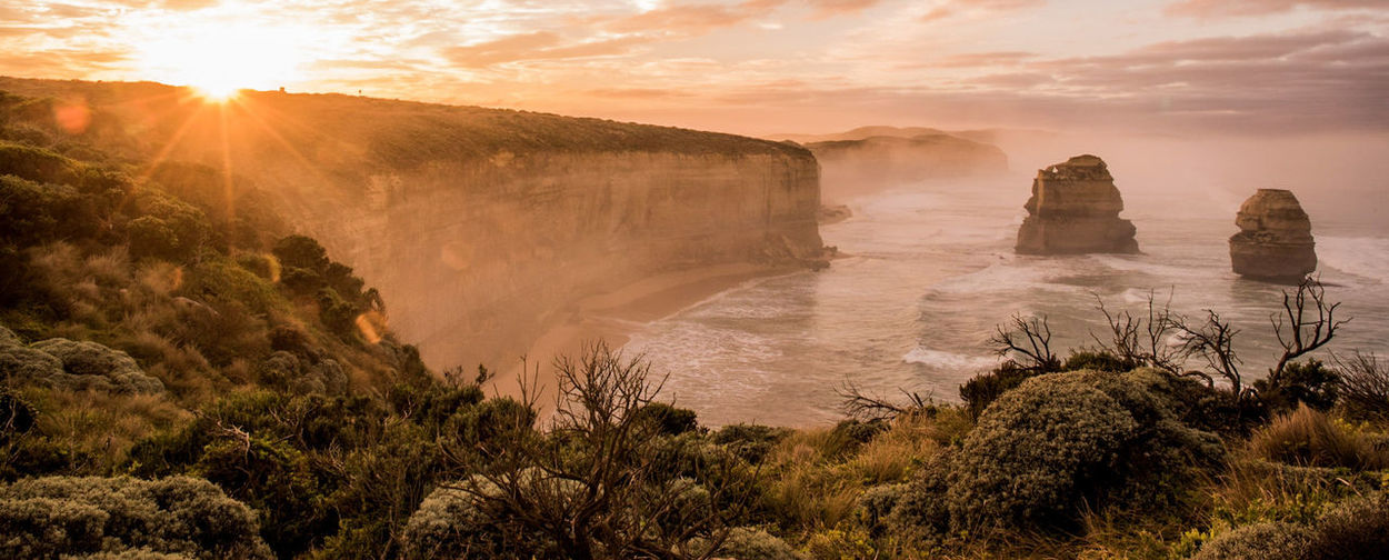 Scenic View Of Great Ocean Road During Sunset