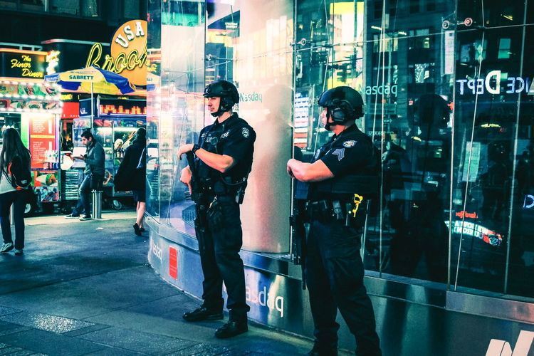 New York, USA - 26 September 2016: NYPD officers on the beat in Times Square, Manhattan. Manhattan NYPD NYPD Times Square On The Beat Patrol  Security Tourist City Cop Law Enforcement Men Night Outdoors Patroling People Police Real People Safety Standing Tourism Two People