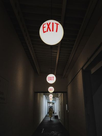 This way exit. Signs Exit Exhibition Hall Dark HUAWEI Photo Award: After Dark Light And Shadow Sign Communication Architecture Direction The Way Forward Built Structure Text Lighting Equipment Indoors  Ceiling Illuminated Hanging Tunnel Diminishing Perspective Guidance