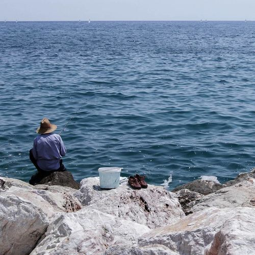 EyeEmNewHere Sea One Person Sitting Water Horizon Over Water Nature Day Outdoors Men Greece Street The Street Photographer - 2017 EyeEm Awards