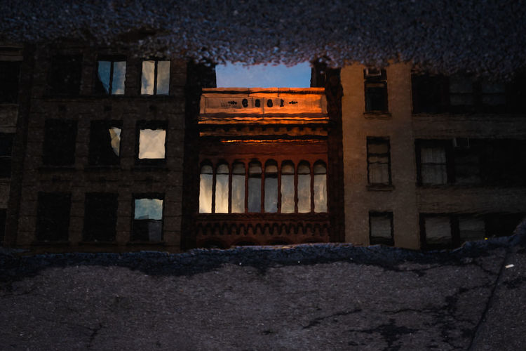 Old building against sky at night