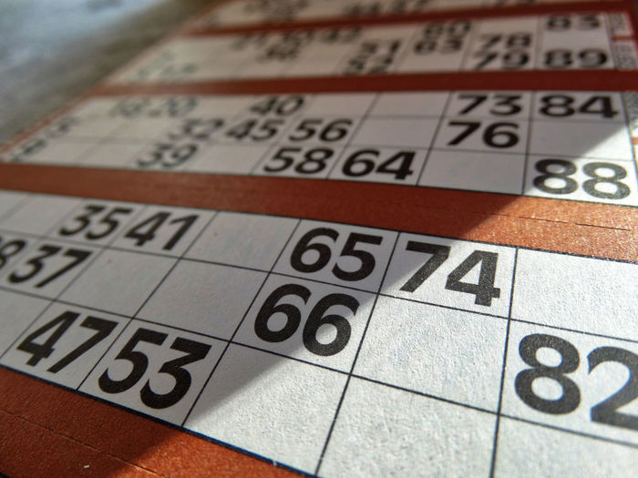 Bingo cards. Number Indoors  Close-up Leisure Games Arts Culture And Entertainment Communication Text Table Western Script Paper Selective Focus Luck Red Leisure Activity Bingo Bingo Card Bingo Cards Lottery Lottery Ticket Lucky Game Gambling Games