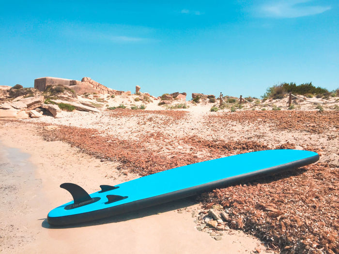A surfboard on the beach of Colonia de Sant Jordi, Mallorca - Spain Surfboard Board Beach Mallorca SPAIN Catalonia Balearic Islands Mediterranean  Sport Watersport Outdoor Holiday Travel Destination Relaxing Recreation  Colorful Blue No People Sandy Beach