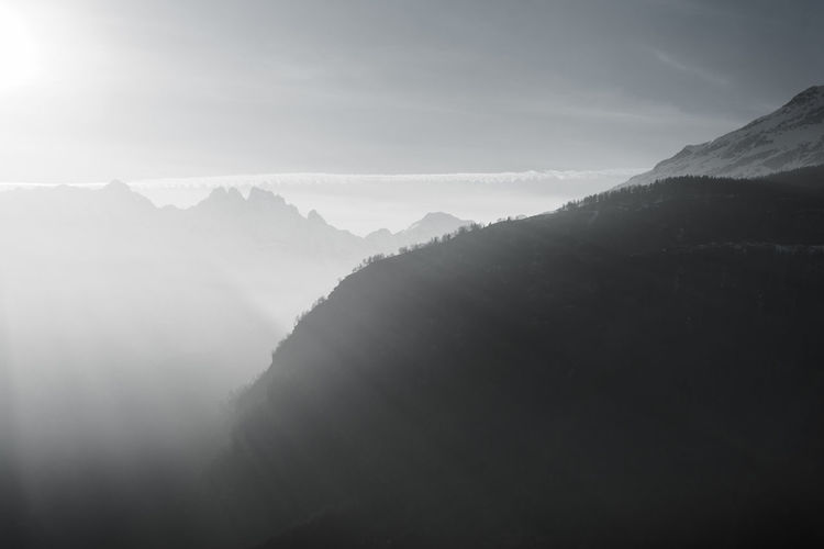 Why wouldn't you love the alps? Mountains ranges in the Kanton of Tessin in Southern Switzerland. Gotta love the majestic forms and tranquility. Beauty In Nature Tranquil Scene Mountain Tranquility Fog Scenics - Nature Sky Nature Day Mountain Range Environment Landscape Idyllic Outdoors Majestic Cloud - Sky Cold Temperature Hazy  Mountain Peak Berge Landschaft Nebel Frühling Spring Sun