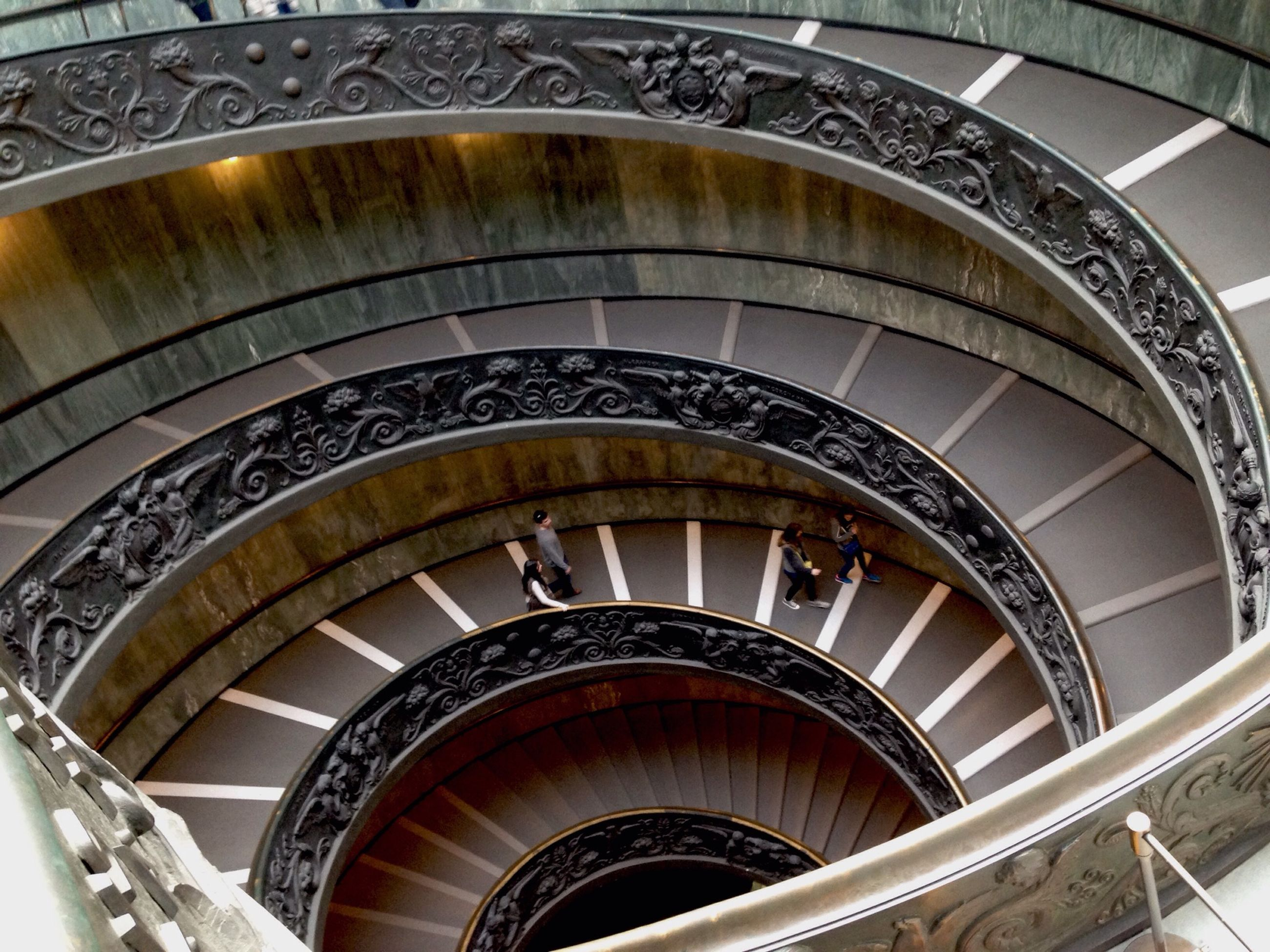staircase, steps and staircases, steps, architecture, built structure, indoors, spiral staircase, railing, spiral, arch, low angle view, pattern, design, stairs, ceiling, architectural feature, directly below, high angle view, building, building exterior