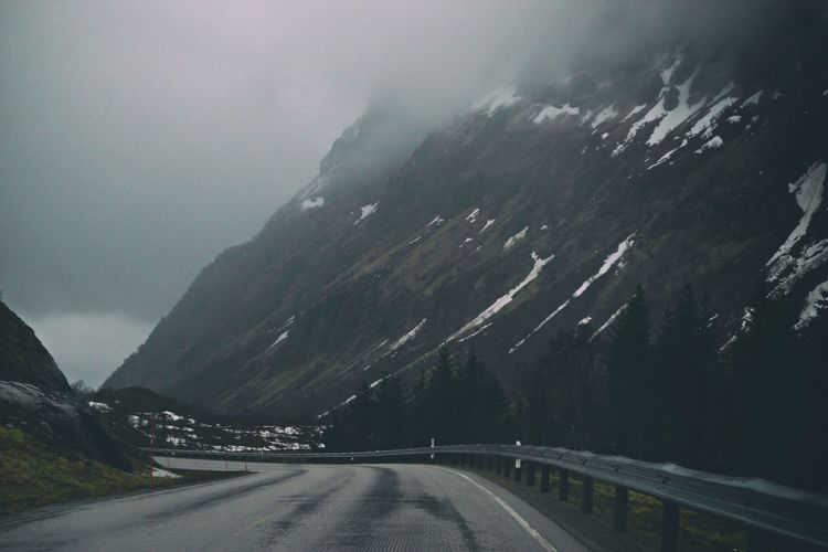 Nature Nature_collection Beauty In Nature Lofoten Islands Lofoten Norway Mountain Range Europe Mountain Tree Winding Road Fog Snow Road Curve Winter Rural Scene Landscape Mountain Road Storm Cloud Country Road Empty Road Atmospheric Mood vanishing point Summer Road Tripping