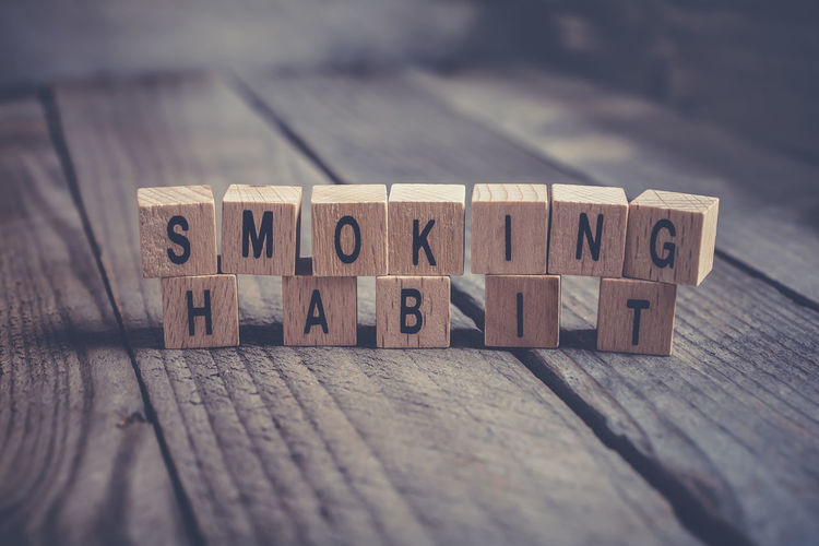 Closeup Of The Words Smoking Habit Formed By Wooden Blocks On A Wooden Floor Blocks Cancer Cancle Drugs Healthcare Smoke Smoking Text Addiction Board Change Cigar Cigarette  Close-up Floor Habit Healthy Lifestyle Macro Message Quit Reminder Stop Weed Wooden Words