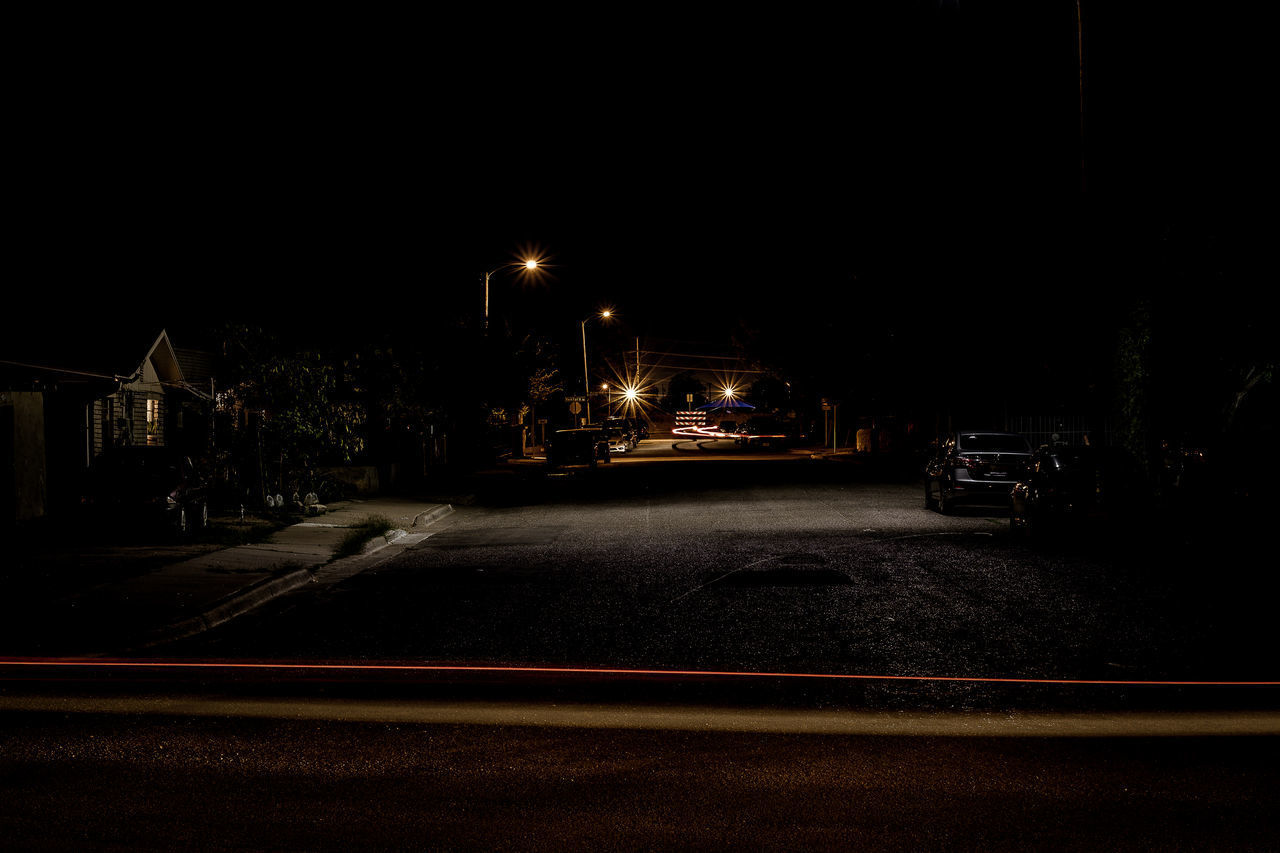 illuminated, night, transportation, street, city, road, motion, car, motor vehicle, mode of transportation, architecture, land vehicle, no people, sky, street light, light trail, built structure, on the move, lighting equipment, nature, outdoors, dark