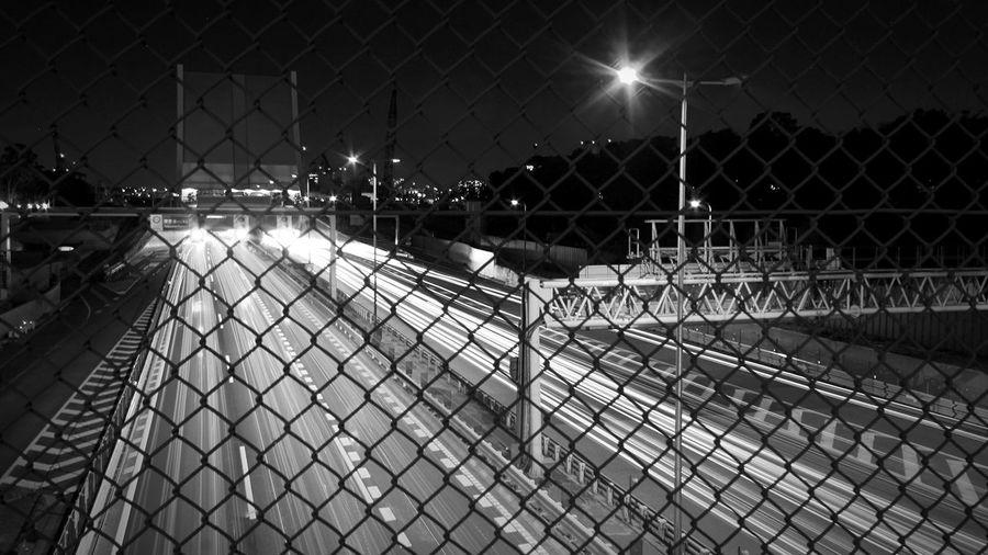 Chainlink Fence Bridge Highway Night Overnight Success Night Lights Night Photography Long Exposure Metropolis Metropolitan Urban Urban Geometry Urban Landscape Transparent Tokyo Japan CarlZeiss Monochrome Photography Capturing Motion