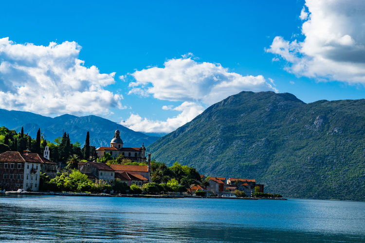 Montenegro Architecture Beauty In Nature Blue Built Structure Cloud Cloud - Sky Day Hill Montenegro Mountain Mountain Range Nature No People Outdoors Rippled River Scenics Sky Town Tranquil Scene Tranquility Tree UNESCO World Heritage Site Water Waterfront