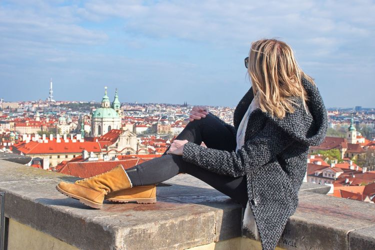 Architecture Building Exterior Built Structure Real People City One Person Women Sky Adult Lifestyles Day Leisure Activity Blond Hair Building Hair Cityscape Travel Destinations Outdoors Warm Clothing Looking At View Hairstyle View Panorama Sitting Travel Tourist Tourism Prague Czech Republic