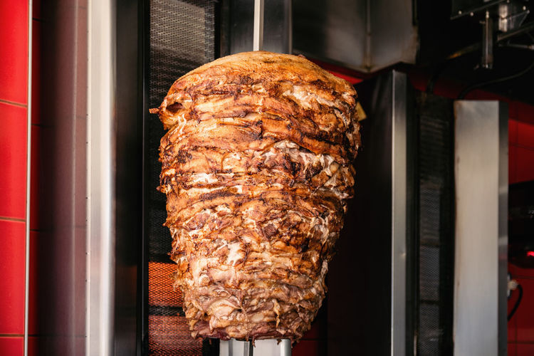 Doner Kebab On Rotating Vertical Spit Doner Kebab Döner Fast Food Kebab Meat Middle East Pork Shawarma Stack Turkish Food Chicken Meat Close-up Food Greek Food Grilled Kebab Kebab Shop Kebap Lamb - Meat Meat Ready-to-eat Roasted Rotating Rotisserie Turkey Meat Vertical