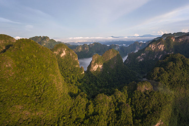 Rainforest with limestone mountains surrounding. Sunrise In the south of Thailand