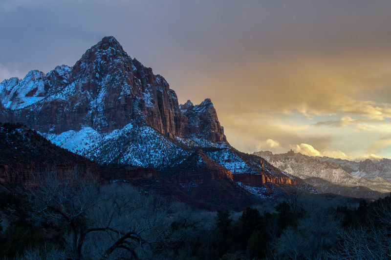 The Watchman catching last rays of sunlight in Zion National Park Mountain Sky Scenics - Nature Mountain Range Beauty In Nature Cloud - Sky Tranquil Scene Nature Sunset No People Tranquility Non-urban Scene Environment Landscape Rock Rock Formation Cold Temperature Remote Idyllic Mountain Peak Outdoors Formation Snowcapped Mountain The Watchman Zion National Park USA Travel Destinations Winter