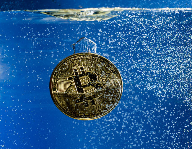 Close-up of bitcoin in water