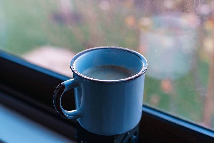 Cup Drink Food And Drink Mug Refreshment Focus On Foreground Close-up Tea Cup Window Coffee Cup Table Day Still Life No People Glass - Material Coffee Indoors  Coffee - Drink Transparent Hot Drink Freshness Crockery