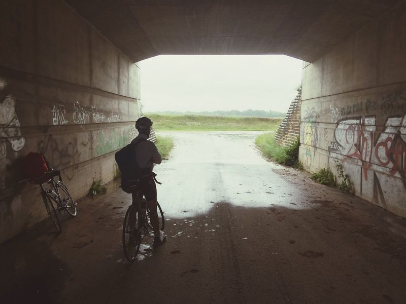 Having A Break Under The Bridge Heavy Rain On The Long Road To Paris Share Your Adventure