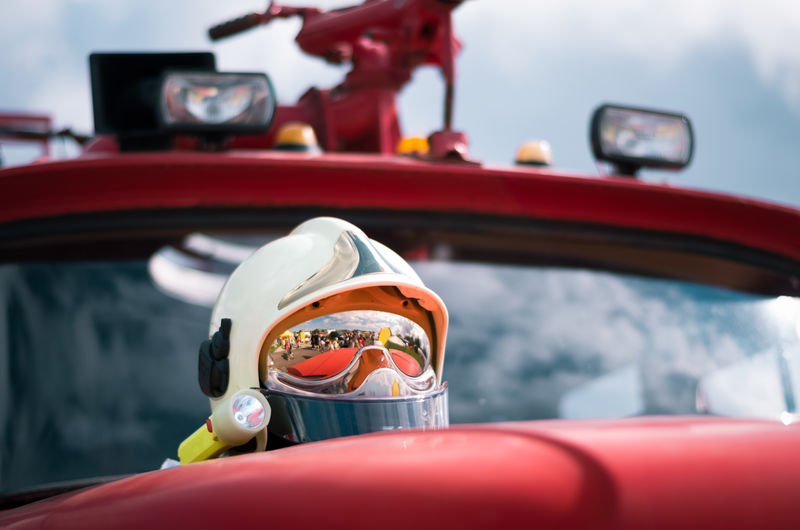 Low angle view of helmet on fire engine