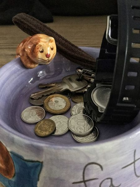 Coins, keys and watch in a fat cat kitty bowl .. Coins Keys Watch Fat Cat Kitty Bowl Tip Bowl Loose Change Cents  Penny Money Currency Singapore Measly Tips Poor  Rich Or Poor Savings Gold And Silver  Shillings And Pence Wealth Cash No People Indoors  Day