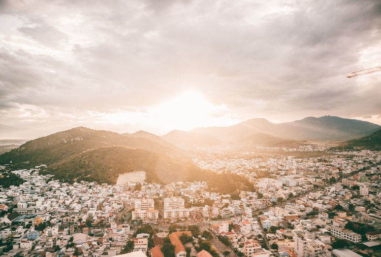 Nha Trang cityview on sunset Architecture Bright Building Building Exterior Built Structure City Cityscape Cloud - Sky Crowd Crowded Day Environment High Angle View Lens Flare Mountain Nature Office Building Exterior Outdoors Residential District Sky Sun Sunlight Town TOWNSCAPE