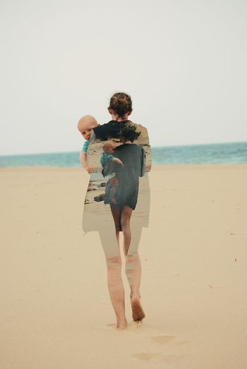 Multiple image of woman carrying baby boy at beach