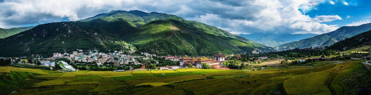Panoramic view of houses and mountains against sky