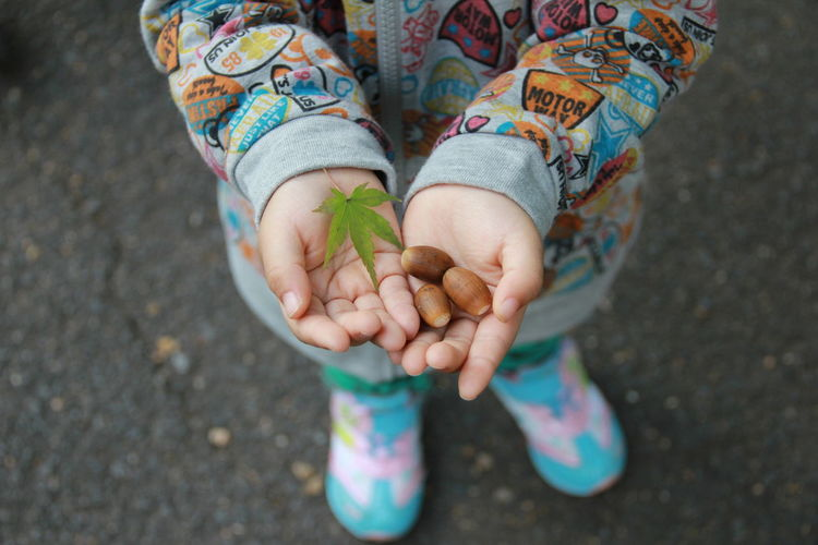 Low section of child holding hands