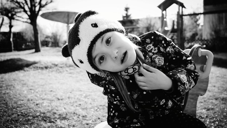 DON'T LOOK| I think it's cooler in black and white 😊 Child Portrait Children Only Childhood Outdoors Looking At Camera Day Cute Grass People Girls Nature Life Beauty Sigma19mmArt Nex6 Closeup Lifestyles EyeEm Gallery Headshot Lightroom VSCO Film Sunny Spring Blackandwhite The Portraitist - 2017 EyeEm Awards