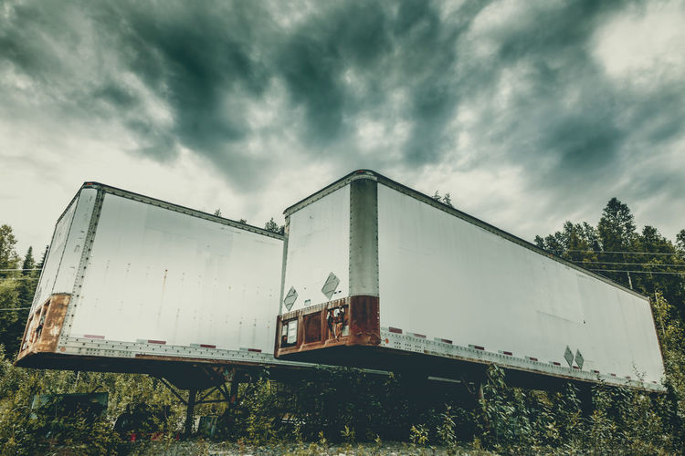 Low angle view of abandoned train against sky