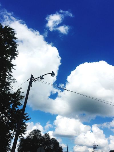 Clouds. Cloud - Sky Low Angle View Sky Cable Connection Silhouette Power Line  Day Tree Amateurphotography Blue No People Nature Telephone Line I See Elephants