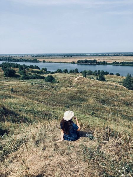 Waiting for summer One Person Land Real People Nature Hat Day Leisure Activity Lifestyles Plant Grass Field Environment Beauty In Nature Sky Landscape Casual Clothing Clothing Sitting Scenics - Nature Outdoors Russia Konstantinovo Russian Girl Enjoying The View View