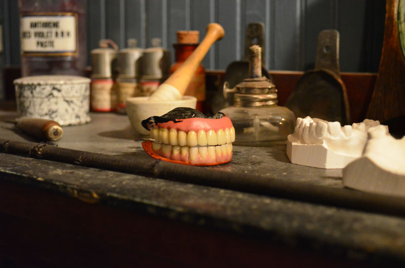 Dentures and objects on table at museum