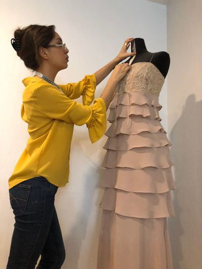 Dressmaker Measure Tape Needlewoman Manikin Dressmaker EyeEm Selects Women Standing Clothing People Girls Adult Offspring Females Three Quarter Length Indoors  Side View Holding Lifestyles Yellow Fashion Dress