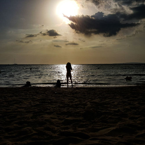As the sunsets on another day, may all your stresses fade away.... Water Sea Full Length Sunset Beach Standing Silhouette Reflection Shore Horizon Over Water Sand Sun Ocean