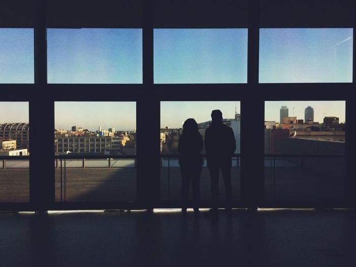 Two People Looking At City