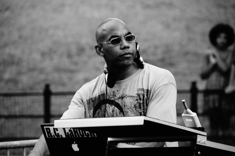 DJ in Central Park ADMIRING Backround Lover Bald Head Casual Clothing Central Park - NYC Close-up Cool Guy Day Dj Dj At Work EyeEm Best Shots EyeEm Gallery Focus On Foreground Headshot Human Meets Technology Leisure Activity Lifestyles Mixing Sessions New York City Monochrome Photography Portrait Sunglasses Feel The Journey Natural Light Portrait Music Brings Us Together