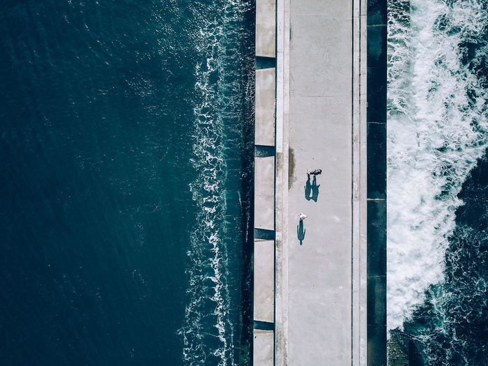 Walking between Waves Water Sea Nature High Angle View Wake - Water Beauty In Nature Vacations Wave Lifestyles Aerial View DJI Mavic Pro Dji Dronephotography First Eyeem Photo Travel Destinations Blue Day Motion People Drone Photography Aerial Perspectives On Nature Landscape Outdoors Real People Be. Ready. EyeEmNewHere Perspectives On Nature The Great Outdoors - 2018 EyeEm Awards