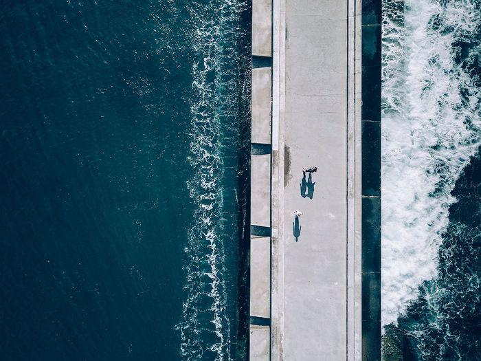 Drone view of bridge over sea