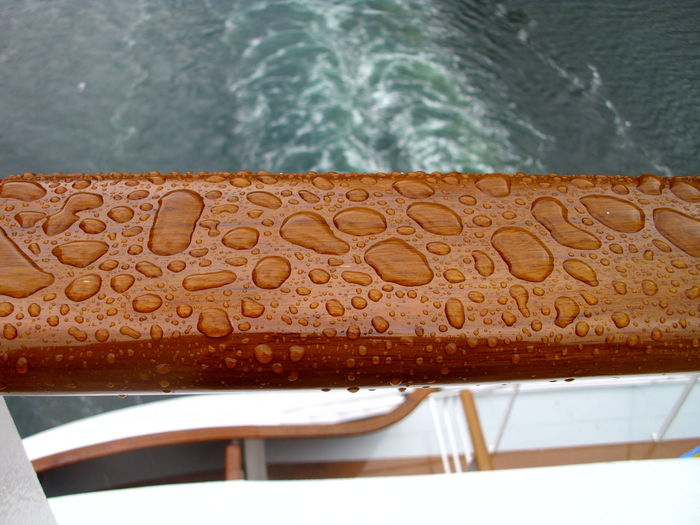 High angle view of wet railing