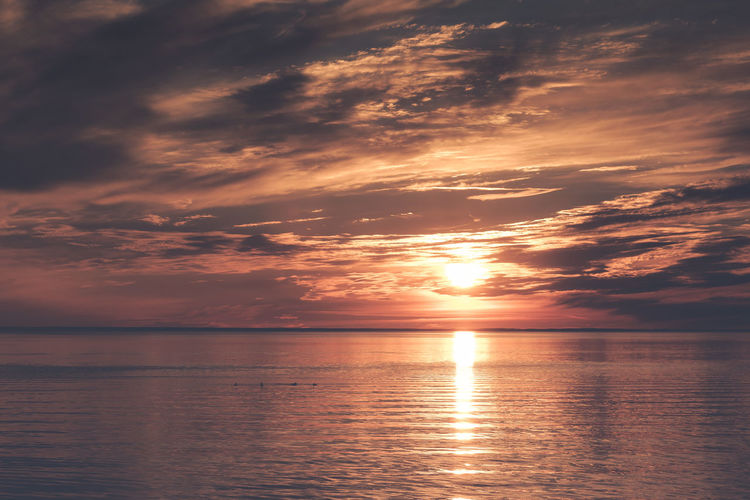 Scenic view of sea against sky during sunset Water Sky Tranquility Cloud - Sky Beauty In Nature Scenics - Nature Sea Reflection Tranquil Scene Sunset Horizon Over Water Horizon Waterfront Nature Idyllic No People Non-urban Scene Seascape Orange Color Outdoors Sun Evening Sun Evening Light Dusk