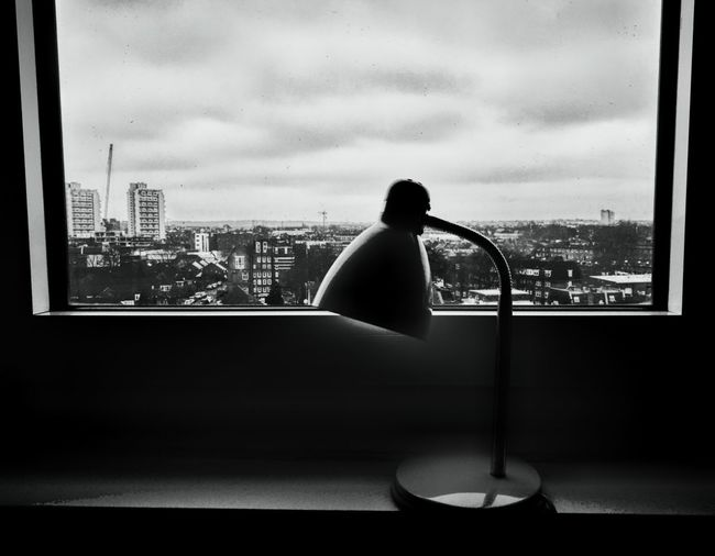 Sadness Window Looking Through Window Indoors  Day Sky City Lamp Black And White Object