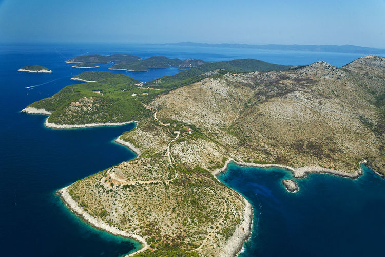 Aerial view of bay against clear blue sky