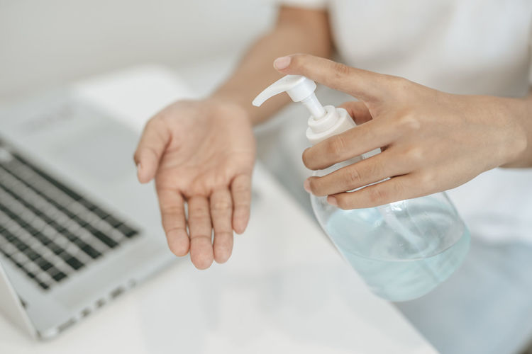 Close-up of human hand on table
