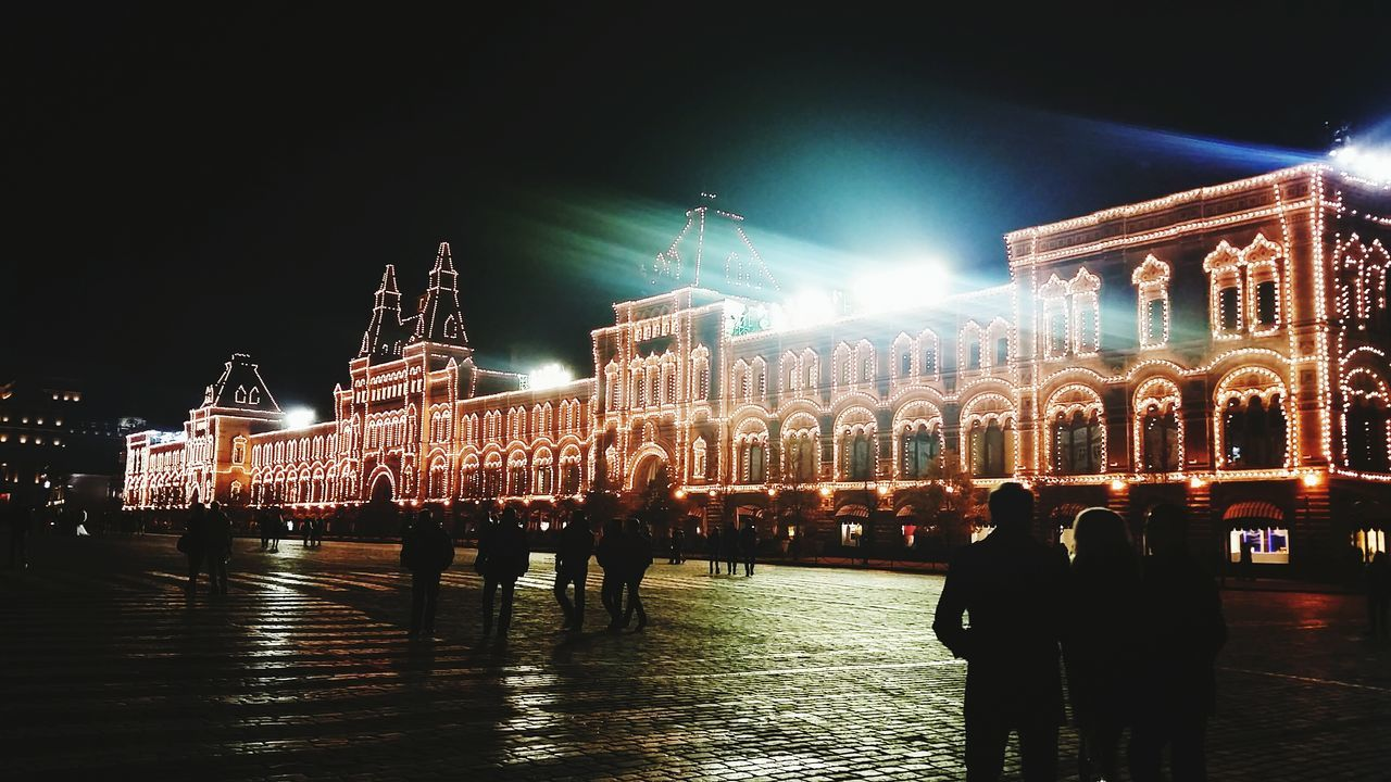 night, illuminated, built structure, architecture, tourism, building exterior, large group of people, real people, travel, travel destinations, leisure activity, outdoors, lifestyles, men, women, sky, city