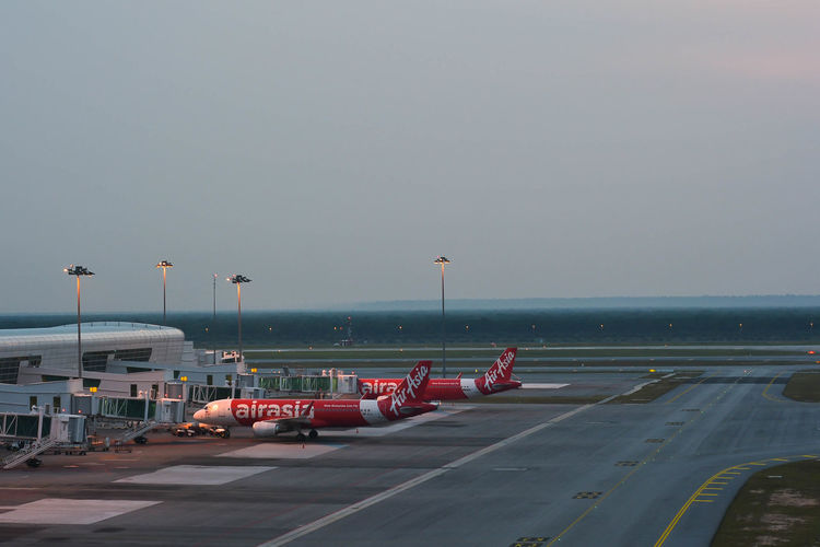 Airplanes in KLIA 2 Airport. KLIA 2 is the low-cost carrier terminal at Malaysia's main international airport KLIA. Aeroplane Air Asia Airport Arrival Aviation Cabin Comercial Airline Cost Day Departure Fly Gate Hangar International KLIA International Airport KLIA2 Kuala Lumpur Malaysia  Low Malaysia Runway Take Off Terminal Transportation Travel