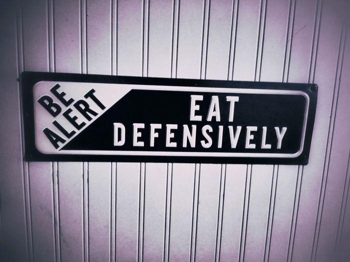 be alert eat defensively Sign Funny Eating Alert Communication Store Text Supermarket Western Script Close-up
