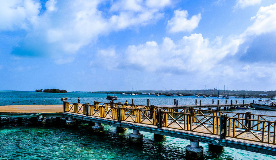 San Andrés Islas. Beauty In Nature Blue Calm Cloud Cloud - Sky Cloudy Day Horizon Over Water Idyllic Nature No People Non-urban Scene Ocean Outdoors Pier Remote Rippled Scenics Sea Seascape Sky Tranquil Scene Tranquility Travel Destinations Water