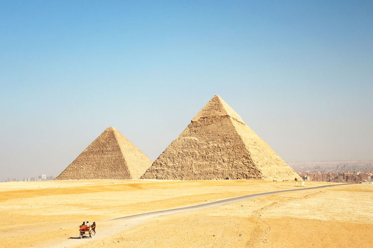Scenic view of pyramids against sky