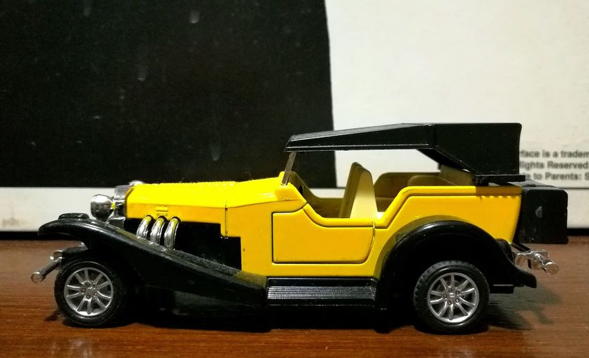 No People Land Vehicle Transportation Mode Of Transport Yellow Car Parking Side View Stationary Old-fashioned Motor Vehicle Vibrant Color Toy Car Objects Toyphotography Small Objects Vibrant Color Toy Car Replica  Around Me Check This Out Macro Automobile Automotive