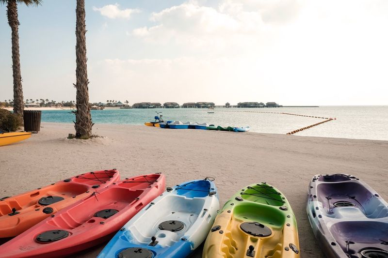 Kayak beside the beach Banana Island Beach Qatar Doha Kayaking Kayak Water Beach Sea Sky Land Sand Nature Day Horizon Over Water Horizon Sunlight Incidental People Tranquil Scene Outdoors Scenics - Nature Tranquility Beauty In Nature Transportation